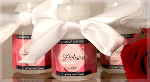 Translucent bubble bottle wedding favors with personalized pink labels